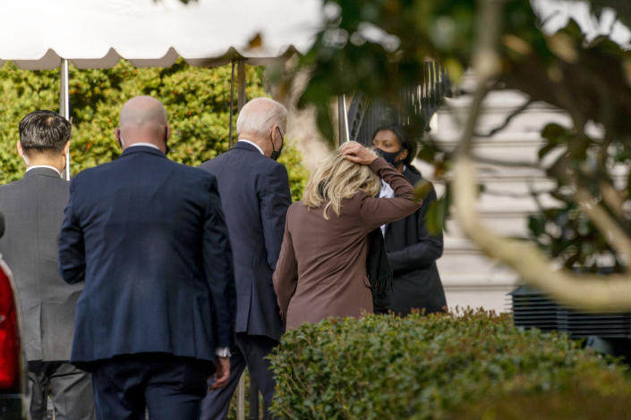 """President Joe Biden and first lady Jill Biden arrive back at the White House after the first lady went to an appointment for a """"common medical procedure"""" at an outpatient center in Washington, Wednesday, April 14, 2021. The Bidens were scheduled to go to an outpatient center in downtown Washington, which the White House did not identify. (AP Photo/Andrew Harnik)"""