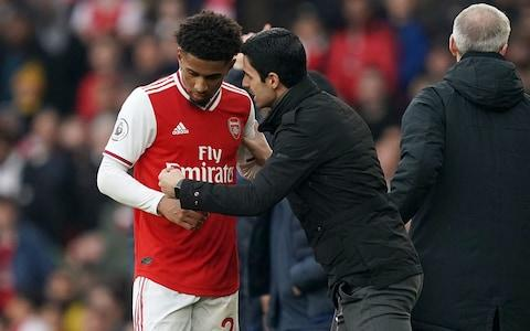 Arsenal manager Mikel Arteta (right) gives intructions to Reiss Nelson from the touchline during the Premier League match at The Emirates Stadium - Credit: PA