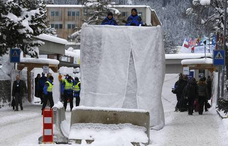 Swiss police officers control the area at the Davos Congress Centre during the Annual Meeting 2016 of the World Economic Forum (WEF) in Davos, Switzerland January 20, 2016. REUTERS/Ruben Sprich