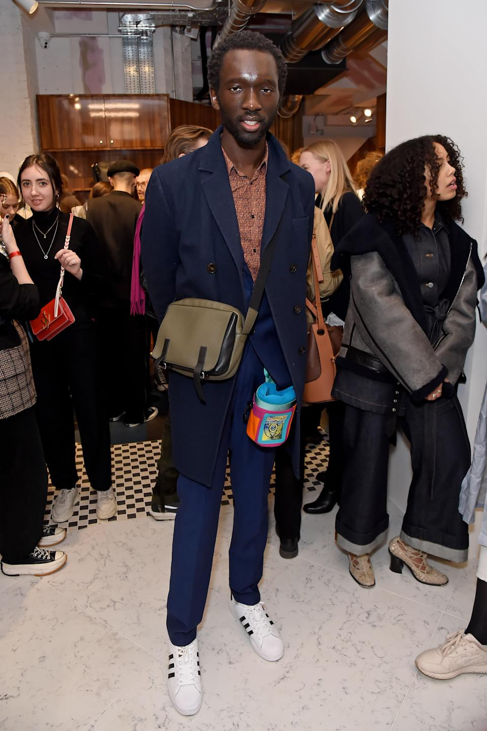 <p>WHERE: The opening of the JW Anderson flagship store in London </p> <p>WHEN: March 12, 2020 </p> <p>WHY: The model presents a convincing theory that two bags are better than one. </p>