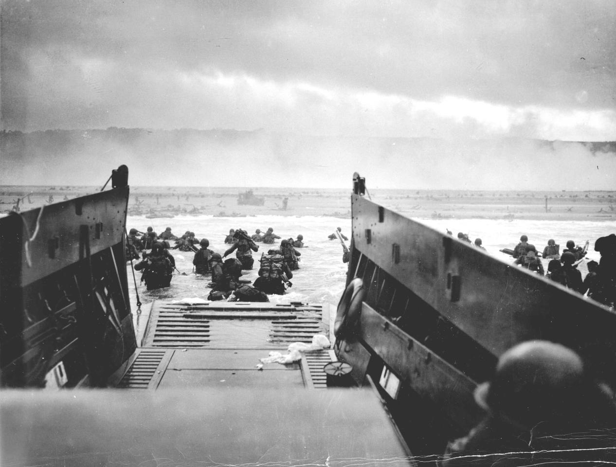 U.S. troops wade ashore from a Coast Guard landing craft at Omaha Beach during the Normandy D-Day landings near Vierville sur Mer, France, on June 6, 1944 in this handout photo provided by the US National Archives. On June 6, 1944, allied soldiers descended on the beaches of Normandy for D-Day - an operation that turned the tide of the Second World War against the Nazis, marking the beginning of the end of the conflict. Today, as many around the world prepare to commemorate the 70th anniversary of the landings, pictures of Normandy's now-touristy beaches stand in stark contrast to images taken around the time of the invasion. But while the landscape has changed, the memory of the momentous event lives on. Reuters photographer Chris Helgren compiled a series of archive pictures taken during the 1944 invasion and then went back to the same places, to photograph them as they appear today. Picture taken June 6, 1944. REUTERS/Robert F. Sargent/US National Archives/Handout via Reuters (FRANCE - Tags: ANNIVERSARY MILITARY CONFLICT) ATTENTION EDITORS - THIS PICTURE WAS PROVIDED BY A THIRD PARTY. REUTERS IS UNABLE TO INDEPENDENTLY VERIFY THE AUTHENTICITY, CONTENT, LOCATION OR DATE OF THIS IMAGE. THIS PICTURE IS DISTRIBUTED EXACTLY AS RECEIVED BY REUTERS, AS A SERVICE TO CLIENTS. FOR EDITORIAL USE ONLY. NOT FOR SALE FOR MARKETING OR ADVERTISING CAMPAIGNS. 