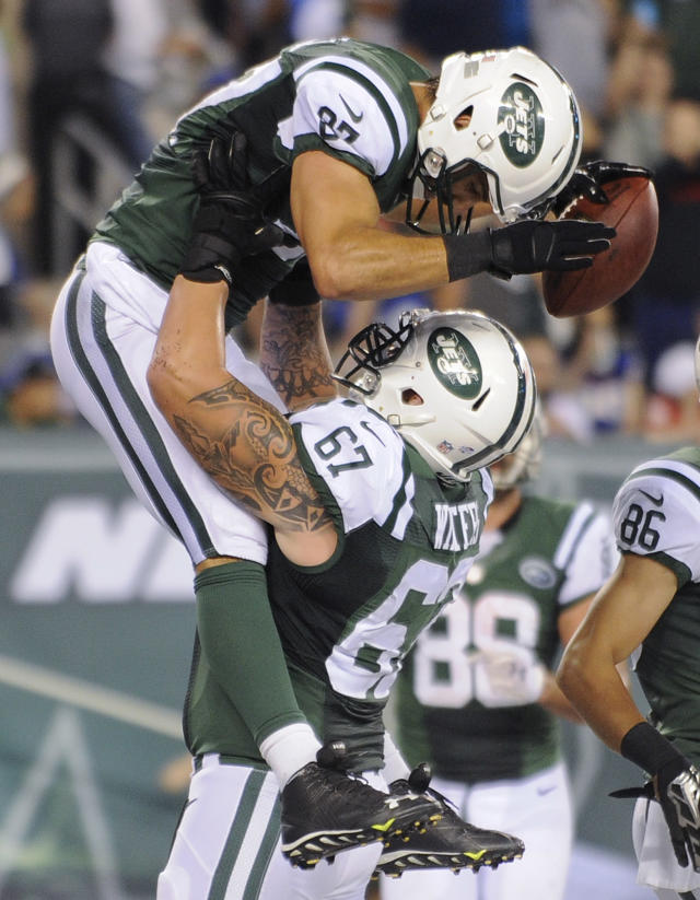 New York Jets wide receiver Eric Decker (87) celebrates with offensive guard Brian Winters (67) after catching a pass for a touchdown against the New York Giants in the third quarter of a preseason NFL football game, Friday, Aug. 22, 2014, in East Rutherford, N.J. (AP Photo/Bill Kostroun)