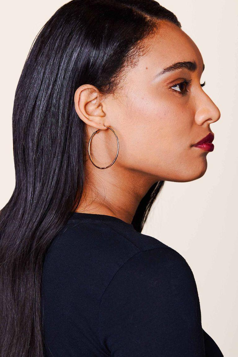 """<p><strong>Madewell</strong></p><p>madewell.com</p><p><strong>$32.00</strong></p><p><a href=""""https://go.redirectingat.com?id=74968X1596630&url=https%3A%2F%2Fwww.madewell.com%2F14k-gold-filled-hoop-earrings-H8534.html&sref=https%3A%2F%2Fwww.elle.com%2Ffashion%2Fshopping%2Fg33078428%2Fbest-elle-editor-product-reviews%2F"""" rel=""""nofollow noopener"""" target=""""_blank"""" data-ylk=""""slk:Shop Now"""" class=""""link rapid-noclick-resp"""">Shop Now</a></p><p>""""I got this <a href=""""https://www.elle.com/fashion/accessories/a20124046/madewell-gold-hoops-review/"""" rel=""""nofollow noopener"""" target=""""_blank"""" data-ylk=""""slk:Madewell pair"""" class=""""link rapid-noclick-resp"""">Madewell pair</a> as a gift and have been obsessed ever since. I can wear them with literally everything and it'll look amazing. In the past, I've experimented with giant hoops so heavy my ears got swole as hell. I've tried itty bitty ones, but they were <em>too</em> small. These, though, are just right. They are the Goldilocks of hoops."""" — <em>Chloe Hall, beauty director</em></p>"""