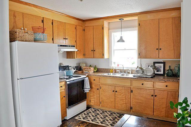 <p>Sometimes, the smallest and least expensive changes make the biggest impact. This blogger wanted to open up one cabinet for shelving and add trim and fresh paint to the rest of the cabinet doors.</p>