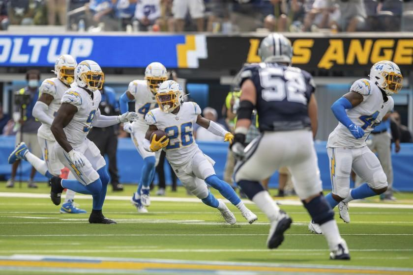 Cornerback (26) Asante Samuel, Jr. of the Los Angeles Chargers intercepts a pass and runs against the Dallas Cowboys in an NFL football game, Sunday, Sept. 19, 2021, in Inglewood, Calif. The Cowboys defeated the Chargers 20-17. (AP Photo/Jeff Lewis)