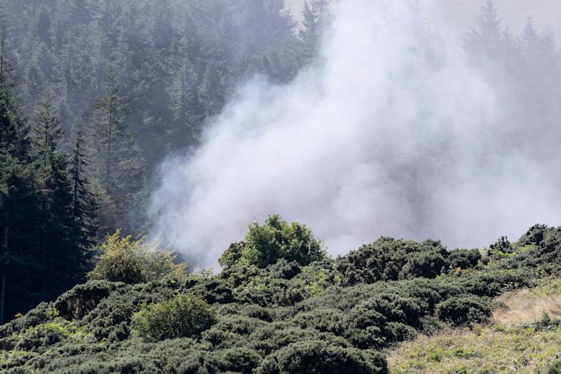 <strong>Smoke billows from the scene of a derailed train in Stonehaven.</strong> (Photo: ASSOCIATED PRESS)