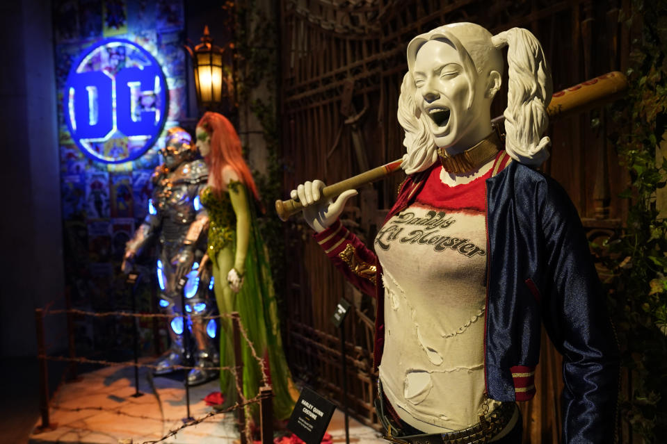 """A Harley Quinn costume is displayed at the """"Action and Magic Made Here"""" interactive experience at the Warner Bros. Studio Tour Hollywood media preview on June 24, 2021, in Burbank, Calif. (AP Photo/Chris Pizzello)"""