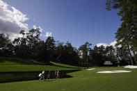 From left, Tommy Fleetwood, of England, Justin Rose, of England, and Collin Morikawa walk up the 16th hole during a practice round for the Masters golf tournament Monday, Nov. 9, 2020, in Augusta, Ga. (AP Photo/David J. Phillip)