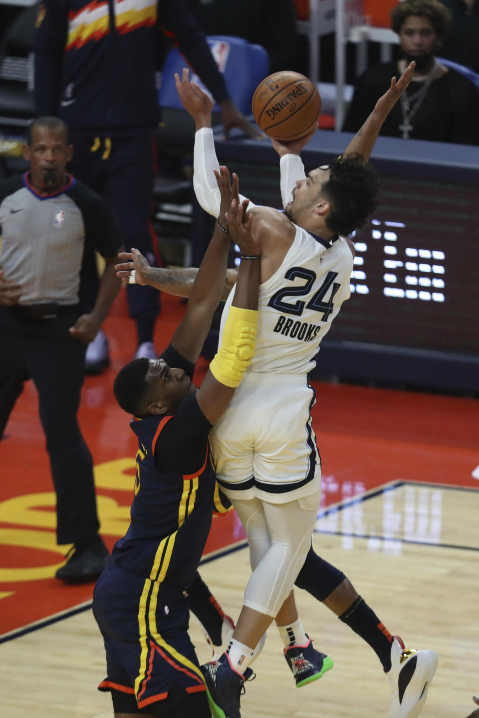Memphis Grizzlies' Dillon Brooks (24) shoots against Golden State Warriors' Kevon Looney during the first half of an NBA basketball Western Conference play-in game in San Francisco, Friday, May 21, 2021. (AP Photo/Jed Jacobsohn)