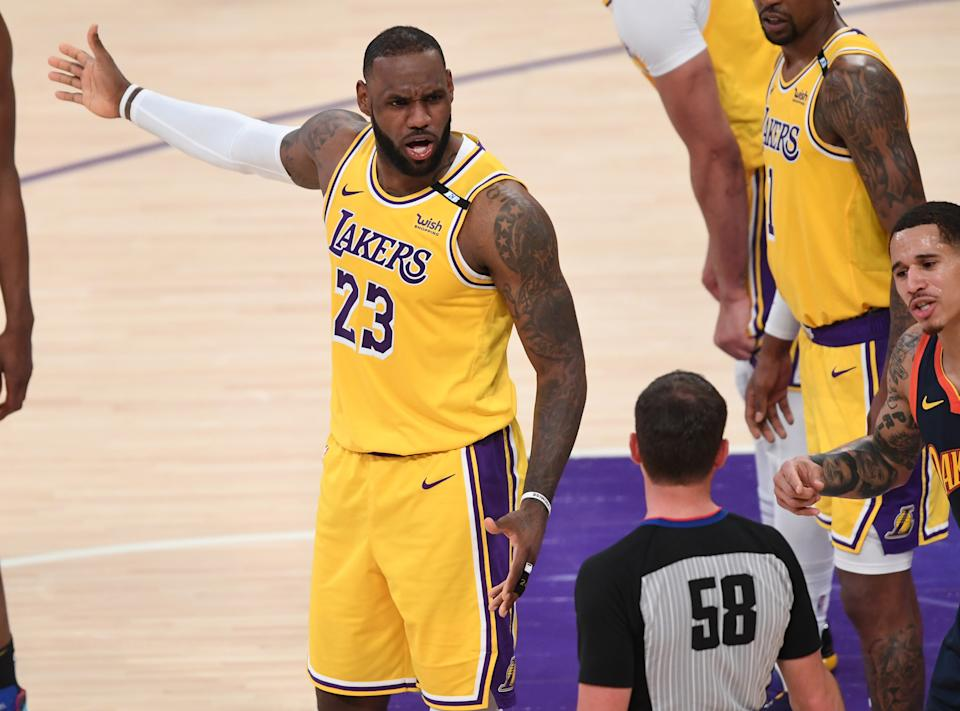 May 19, 2021; Los Angeles, California, USA;    Los Angeles Lakers forward LeBron James (23) and Golden State Warriors forward Juan Toscano-Anderson (95) plead their case to referee Josh Tiven (58) in the first half at Staples Center. Mandatory Credit: Jayne Kamin-Oncea-USA TODAY Sports