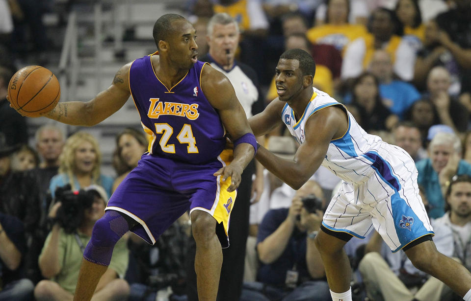 New Orleans Hornets guard Chris Paul defends Los Angeles Lakers guard Kobe Bryant in the 2011 Western Conference quarterfinals. (Jeff Zelevansky/Getty Images)