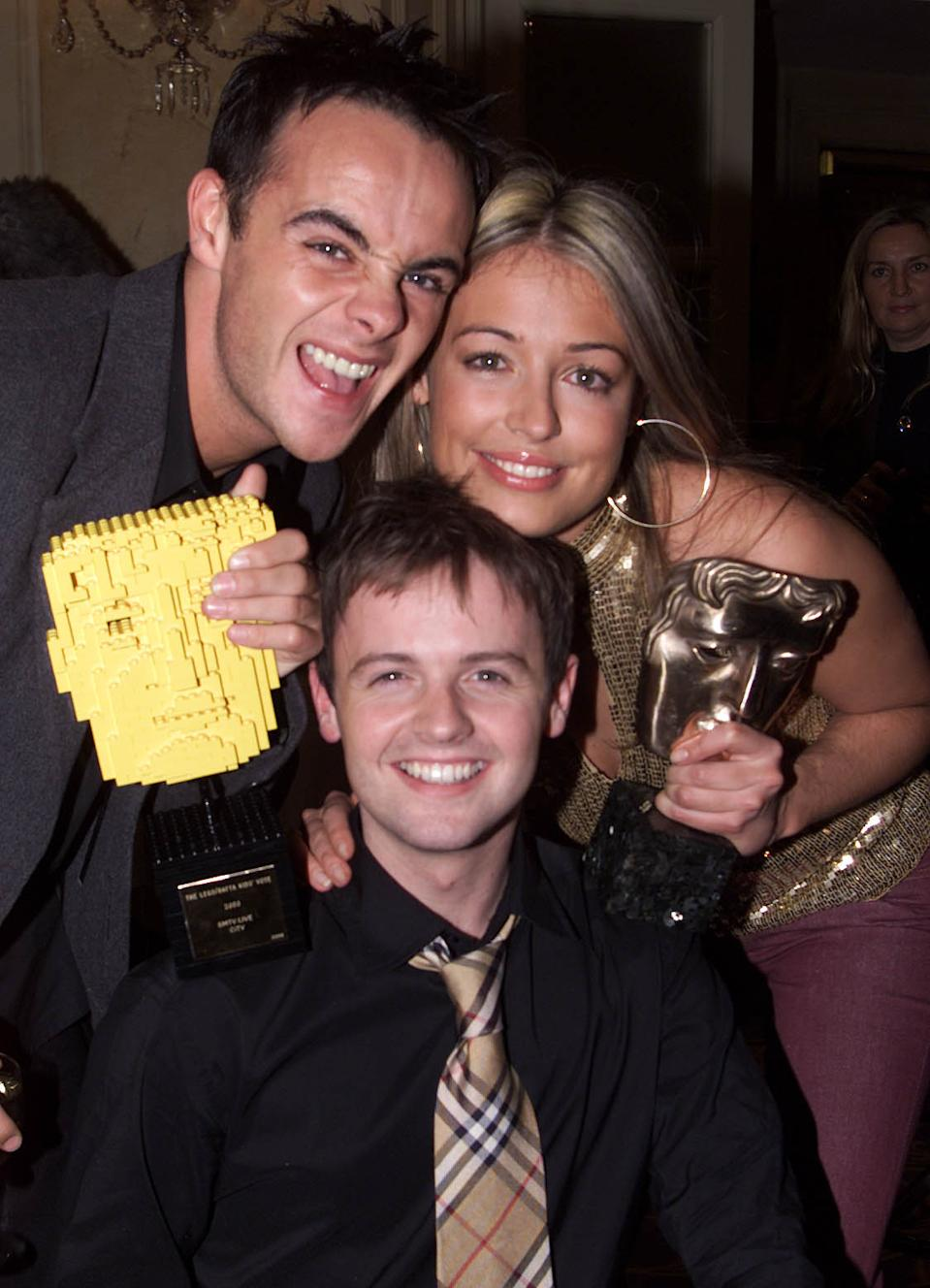 TV presenters Ant and Dec (Ant McPartlin (L) and Declan Donnelly (C)) and Cat Deeley (R) at the British Academy Children's Film & Television Awards at the Park Lane Hilton, London on 24 November, 2002. SM:TV won Best Entertainment Award and the Lego Kid's Vote award. (Photo by Gareth Davies/Getty Images)