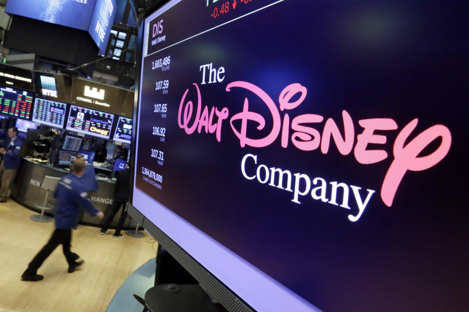 """FILE - In this Aug. 8, 2017, file photo, The Walt Disney Co. logo appears on a screen above the floor of the New York Stock Exchange. The Walt Disney Co. has """"dramatically"""" slashed its advertising budget on Facebook and Facebook-owned Instagram, according to a report in the Wall Street Journal. (AP Photo/Richard Drew, File)"""