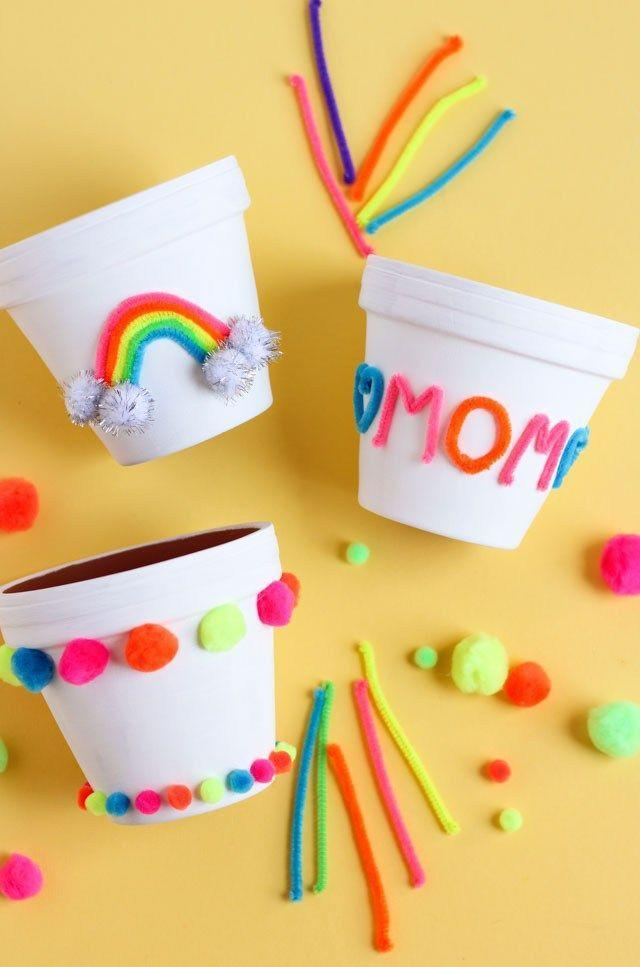 """<p>A terra-cotta pot is a blank canvas for paint, pom-poms, and pipe cleaners. Spell out """"mom"""" with pipe cleaners or go for something more abstract. Don't forget to fill it with a plant or fresh flowers once it's dry! </p><p><em><a href=""""https://designimprovised.com/2018/04/mothers-day-flower-pot-gift-craft-idea.html"""" rel=""""nofollow noopener"""" target=""""_blank"""" data-ylk=""""slk:Get the tutorial at Design Improvised »"""" class=""""link rapid-noclick-resp"""">Get the tutorial at Design Improvised »</a></em></p><p><strong>RELATED: </strong><a href=""""https://www.goodhousekeeping.com/holidays/mothers-day/g20115272/mothers-day-gifts-from-toddlers/"""" rel=""""nofollow noopener"""" target=""""_blank"""" data-ylk=""""slk:Sweet Mother's Day Gifts from Toddlers"""" class=""""link rapid-noclick-resp"""">Sweet Mother's Day Gifts from Toddlers</a></p>"""