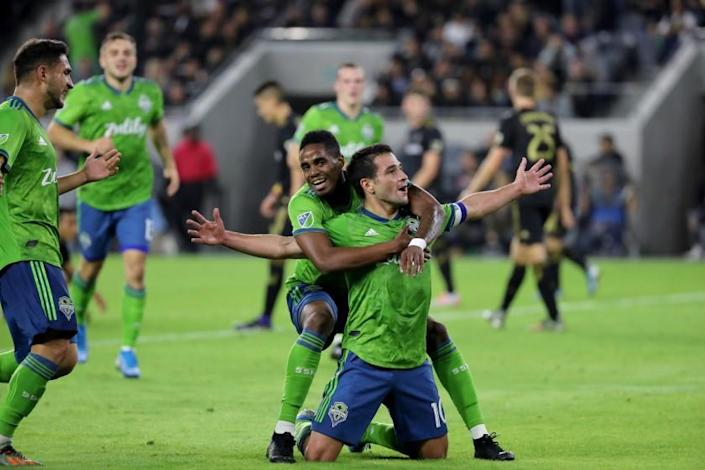 "Seattle Sounders' Nicolás Lodeiro, with teammate Joevin Jones, celebrates his goal against LAFC in the MLS playoffs Oct. 29, 2019, in L.A. <span class=""copyright"">(Allen J. Schaben / Los Angeles Times)</span>"