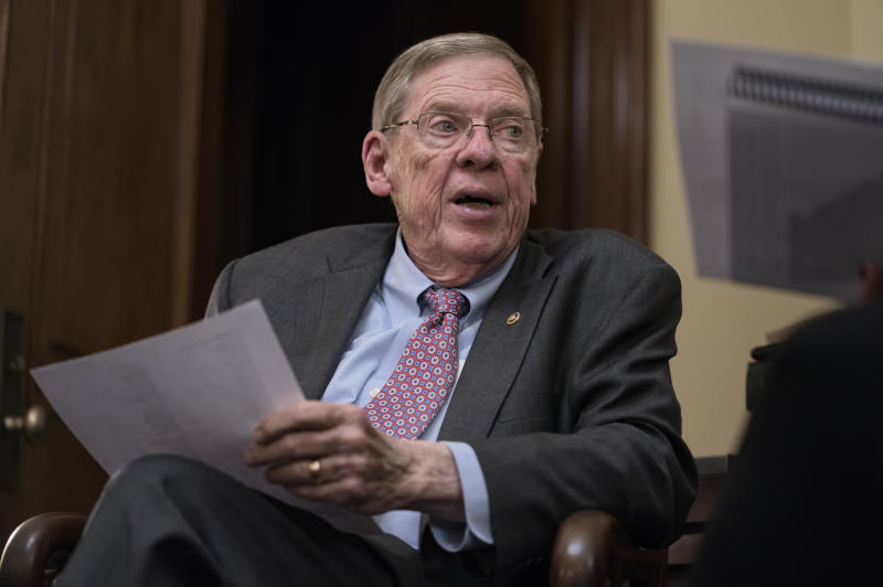 Sen. Johnny Isakson, R-Ga., meets with his staff in his office on Capitol Hill in Washington, Monday, Dec. 2, 2019, as he prepares to deliver his farewell address on the floor of the Senate tomorrow. Isakson, a three-term senator, announced last summer that he would resign from the Senate on Dec. 31 for health reasons. (AP Photo/J. Scott Applewhite)