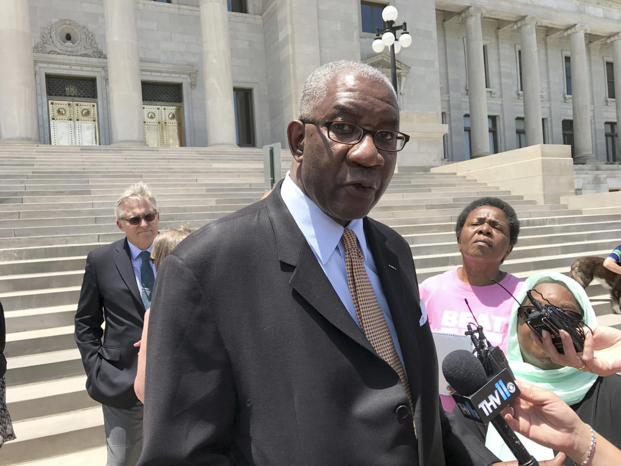 CORRECTS SPELLING OF LAST NAME TO GRIFFEN INSTEAD OF GRIFFIN - FILE - In this June 9, 2017 photo, Circuit Judge Wendell Griffen speaks at a news conference on the steps of the Arkansas State Capitol in Little Rock, Ark. The Arkansas Supreme Court on Thursday, June 21, 2018, cleared the way for the state to launch its medical marijuana program, reversing and dismissing Griffen's ruling that prevented officials from issuing the first licenses for businesses to grow the drug. Griffen ruled in March that the state's process for awarding medical marijuana cultivation licenses was unconstitutional. (AP Photo/Andrew DeMillo, File)