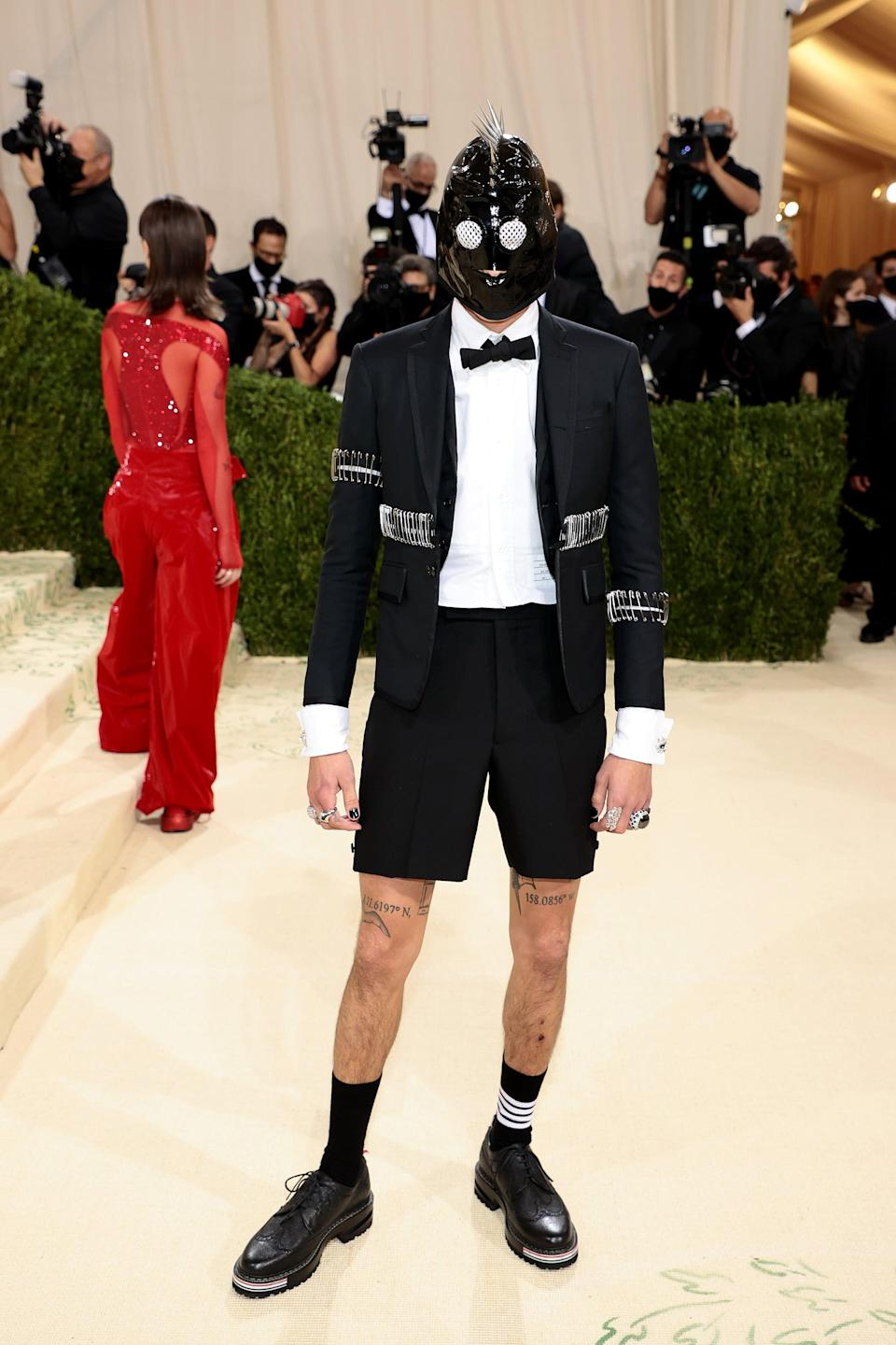 <p>Wearing a Thom Browne suit.</p>