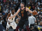 Cleveland Cavaliers forward Kevin Love, front, looks to pass the ball as Denver Nuggets forward Jerami Grant defends during the first half of an NBA basketball game Saturday, Jan. 11, 2020, in Denver. (AP Photo/David Zalubowski)