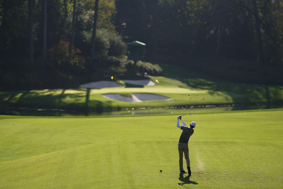 Dylan Frittelli, of South Africa, tees off on the 12th hole during the third round of the Masters golf tournament Saturday, Nov. 14, 2020, in Augusta, Ga. (AP Photo/David J. Phillip)