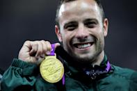South Africa's Oscar Pistorius celebrates with his gold medal after winning the Men's 400m T44 at the Olympic Stadium, London.