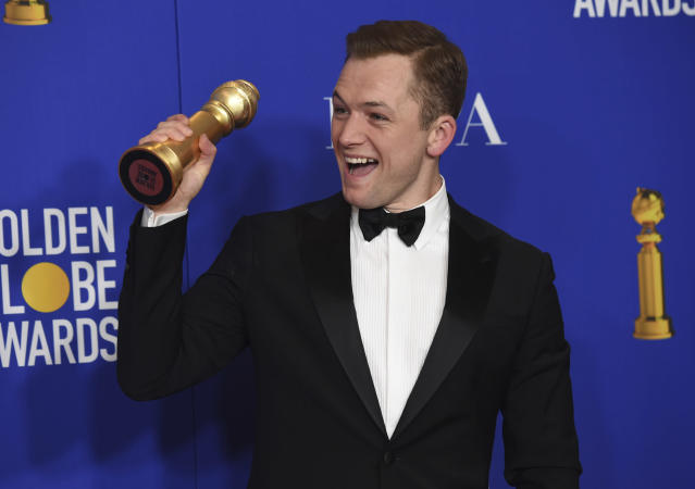 "Taron Egerton poses in the press room with the award for best performance by an actor in a motion picture, musical or comedy, for ""Rocketman"" at the 77th annual Golden Globe Awards at the Beverly Hilton Hotel on Sunday, Jan. 5, 2020, in Beverly Hills, Calif. (AP Photo/Chris Pizzello)"