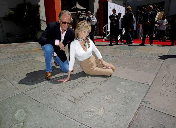 PHOTO: Jane Fonda and her brother, actor Peter Fonda, look at their father's, actor Henry Fonda, handprints and footprints after her hand and footprint ceremony in the forecourt of the Chinese theatre in Hollywood, California, April 27, 2013. (Mario Anzuoni/Reuters, FILE)