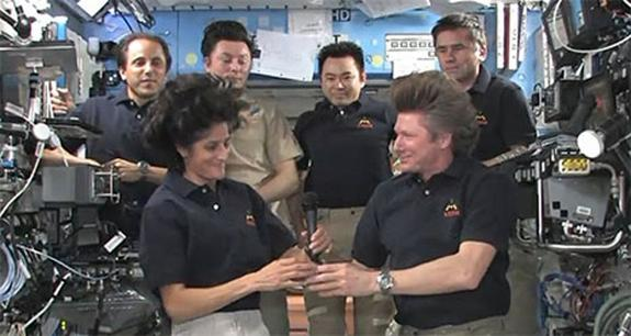 NASA astronaut Sunita Williams (front left) takes command of the International Space Station from cosmonaut Gennady Padalka (front right) during a ceremony marking the start of the Expedition 33 increment aboard the space station on Sept. 15, 2