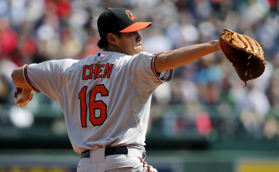 Baltimore Orioles starting pitcher Wei-Yin Chen delivers against the Boston Red Sox during the first inning of a baseball game at Fenway Park in Boston Monday, April 21, 2014. (AP Photo/Winslow Townson)