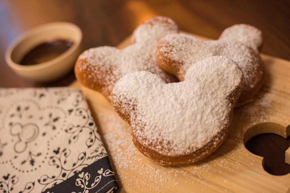 "<p>Getting a Mickey Mouse-shaped snack is basically a Disney vacation requirement. The soft pillows of dough are covered in powdered sugar and served piping hot! If you don't have a Mickey-shaped cookie cutter, rounds or squares will work, and the final product will taste just as good.</p> <p><strong>Get the recipe:</strong> <a href=""http://disneyparks.disney.go.com/blog/2020/04/disneymagicmoments-create-magical-mickey-mouse-shaped-beignets-at-home-with-this-fan-favorite-classic-disney-recipe/"" class=""link rapid-noclick-resp"" rel=""nofollow noopener"" target=""_blank"" data-ylk=""slk:Disney's Mickey Mouse-shaped beignets"">Disney's Mickey Mouse-shaped beignets</a></p>"