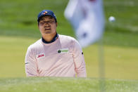 Kyoung-Hoon Lee watches his shot on the 15th hole during the first round of the Wells Fargo Championship golf tournament at Quail Hollow Club on Thursday, May 6, 2021, in Charlotte, N.C. (AP Photo/Jacob Kupferman)