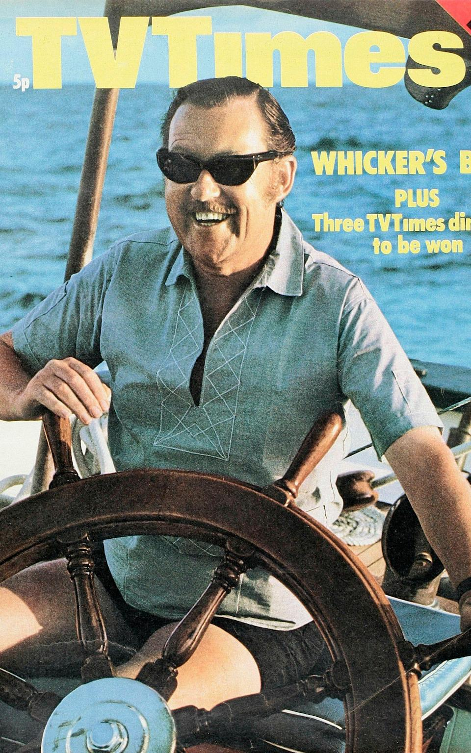TV Times cover featuring television presenter Alan Whicker piloting a boat, circa July 1971 - getty