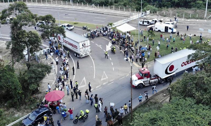 Aerial view of trucks loaded with humanitarian aid for Venezuela driving to the Tienditas Bridge on the border between Cucuta Colombia and Tachira Venezuela where Venezuelan military officers have blocked the bridge