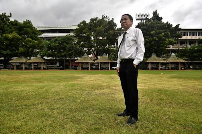 Lawyer Krisadang Nutcharut stands in the football field, where his fellow students were killed during the Thammasat University massacre 40 years ago