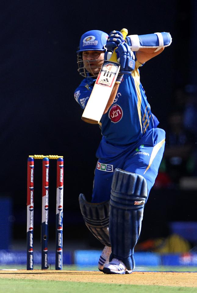 Mumbai Indian player Sachin Tendulkar plays a shot during match 49 of the Pepsi Indian Premier League ( IPL) 2013  between The Mumbai Indians and the Chennai Super Kings held at the Wankhede Stadium in Mumbai on the 5th May 2013 ..Photo by Vipin Pawar-IPL-SPORTZPICS ..Use of this image is subject to the terms and conditions as outlined by the BCCI. These terms can be found by following this link:..https://ec.yimg.com/ec?url=http%3a%2f%2fwww.sportzpics.co.za%2fimage%2fI0000SoRagM2cIEc&t=1506424325&sig=VbpNqJcU_hTrhTrUWgFEXg--~D