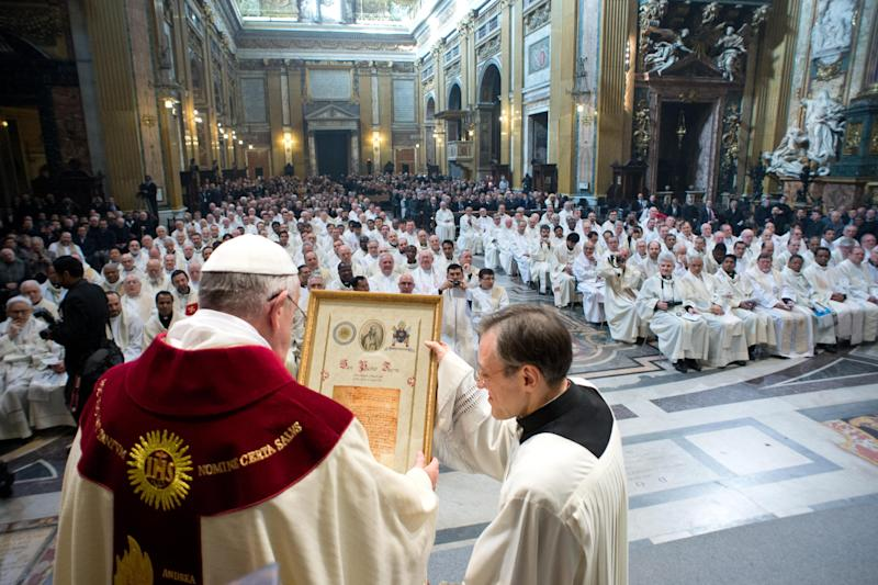 In this photo provided by the Vatican paper L'Osservatore Romano, Pope Francis celebrates a mass with the Jesuits on the occasion of the order's titular feast, in Rome's Jesus' Church, Friday, Jan. 3, 2014. (AP Photo/Osservatore Romano, ho)