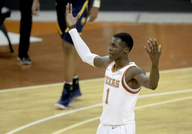 "Texas guard <a class=""link rapid-noclick-resp"" href=""/ncaaf/players/253358/"" data-ylk=""slk:Andrew Jones"">Andrew Jones</a> scored a career-high 20 points in his first game playing significant minutes since being diagnosed with Leukemia. (Nick Wagner/Austin American-Statesman via AP)"