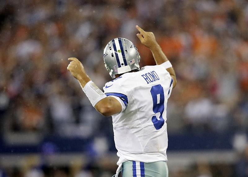Dallas Cowboys quarterback Tony Romo (9) celebrates throwing a touchdown pass to Cole Beasley during the fourth quarter of an NFL football game against the Denver Broncos, Sunday, Oct. 6,2013, in Arlington, Texas. The Broncos won 51-48. (AP Photo/Tony Gutierrez)