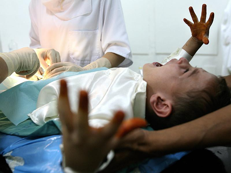 File photo shows a boy screaming during a circumcision at an Algerian hospital: Getty Images