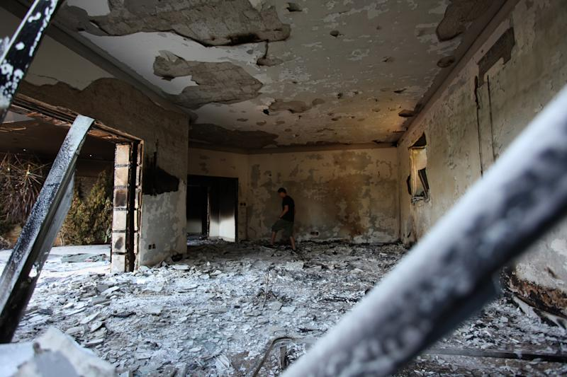 A Libyan man walks in the rubble of the damaged U.S. consulate, after an attack that killed four Americans, including Ambassador Chris Stevens on the night of Tuesday, Sept. 11, 2012, in Benghazi, Libya, Thursday, Sept. 13, 2012. The American ambassador to Libya and three other Americans were killed when a mob of protesters and gunmen overwhelmed the U.S. Consulate in Benghazi, setting fire to it in outrage over a film that ridicules Islam's Prophet Muhammad. Ambassador Chris Stevens, 52, died as he and a group of embassy employees went to the consulate to try to evacuate staff as a crowd of hundreds attacked the consulate Tuesday evening, many of them firing machine-guns and rocket-propelled grenades. (AP photo/Mohammad Hannon)