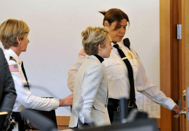 PHOTO: Michelle Carter, center, is led away by court officers after a hearing on her prison sentence in Taunton District Court in Taunton, Mass., Feb. 11, 2019. (Mark Stockwell/The Sun Chronicle via AP, FILE)