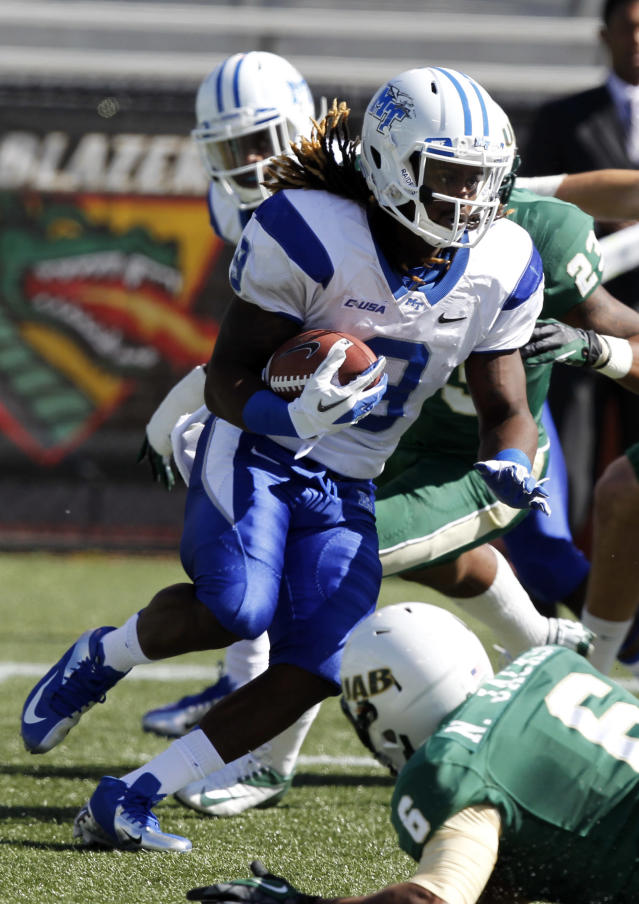 CORRECTS DATE TO NOV. 2, NOT NOV. 1, AND ID TO KYLE GRISWOULD, NOT TAVARRES JEFFERSON - Middle Tennessee State wide receiver Kyle Griswould carries the ball during a kick return in the first half of an NCAA college football game against UAB on Saturday, Nov. 1, 2013, in Birmingham, Ala. (AP Photo/Butch Dill)