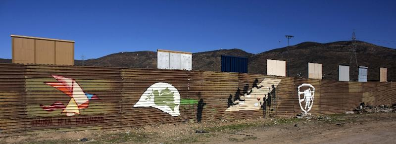 Mexico detained more than 500 undocumented migrants at the weekend; here, border wall prototypes rise at the US/Mexico border in Tijuana, Mexico on January 22, 2018