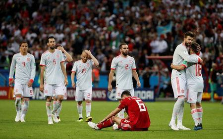 Soccer Football - World Cup - Group B - Iran vs Spain - Kazan Arena, Kazan, Russia - June 20, 2018 Spain's Gerard Pique and Jordi Alba celebrate victory as Iran's Saeid Ezatolahi looks dejected after the match REUTERS/Jorge Silva
