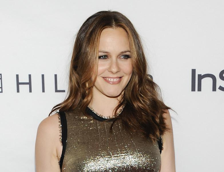 "FILE - This Sept. 13, 2011 file photo shows actress Alicia Silverstone attending the Instyle and Hollywood Foreign Press party at the Windsor Arms Hotel during the Toronto International Film Festival in Toronto. Silverstone is joining the cast of the upcoming Broadway comedy ""The Performers."" Previews begin Oct. 23 and opening night is Nov.14 at the Longacre Theatre in New York. (AP Photo/Evan Agostini, file)"