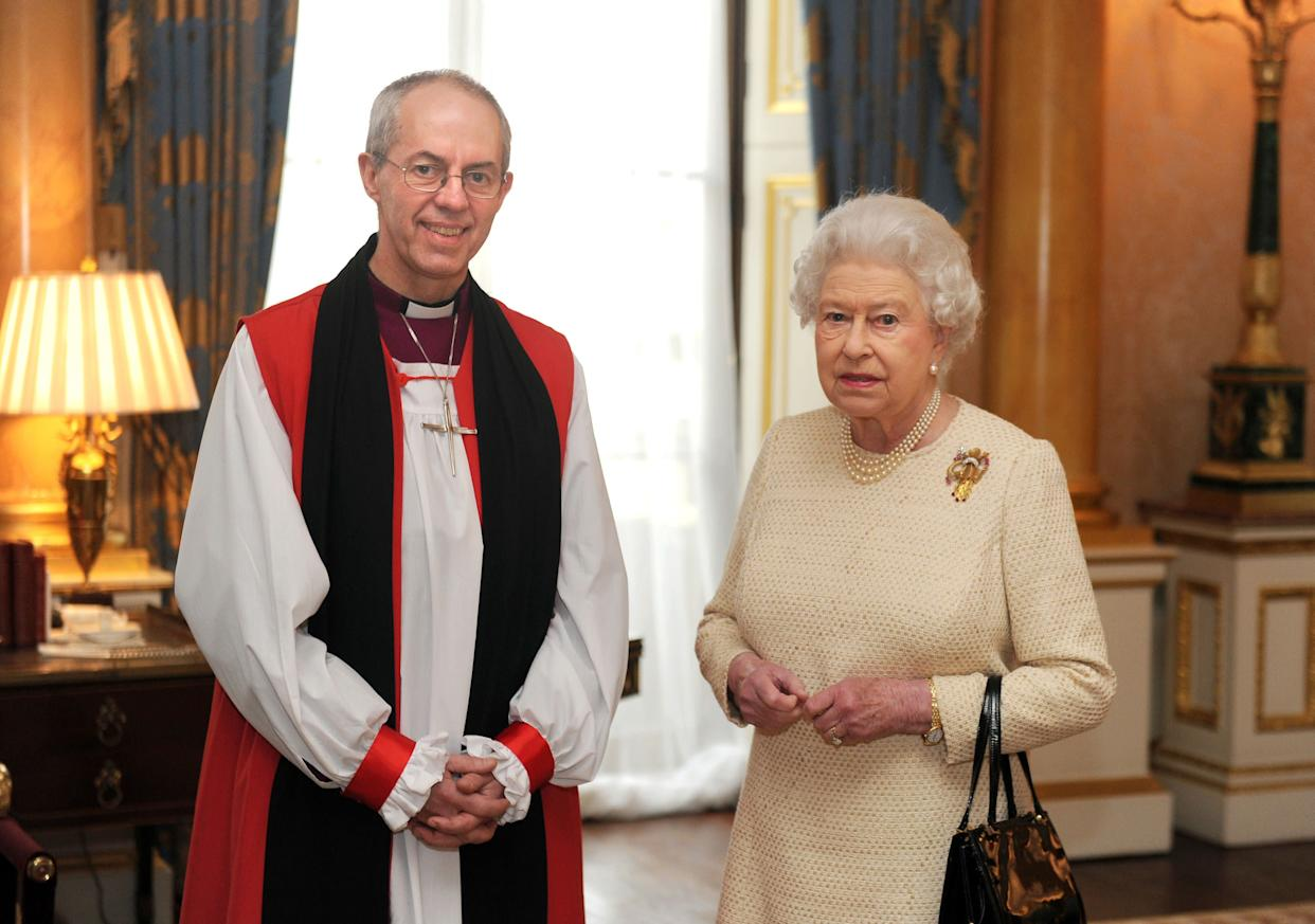 Justin Welby, archbishop of Canterbury, and Queen Elizabeth pose for a photo in February 2013. (Photo: POOL New / Reuters)