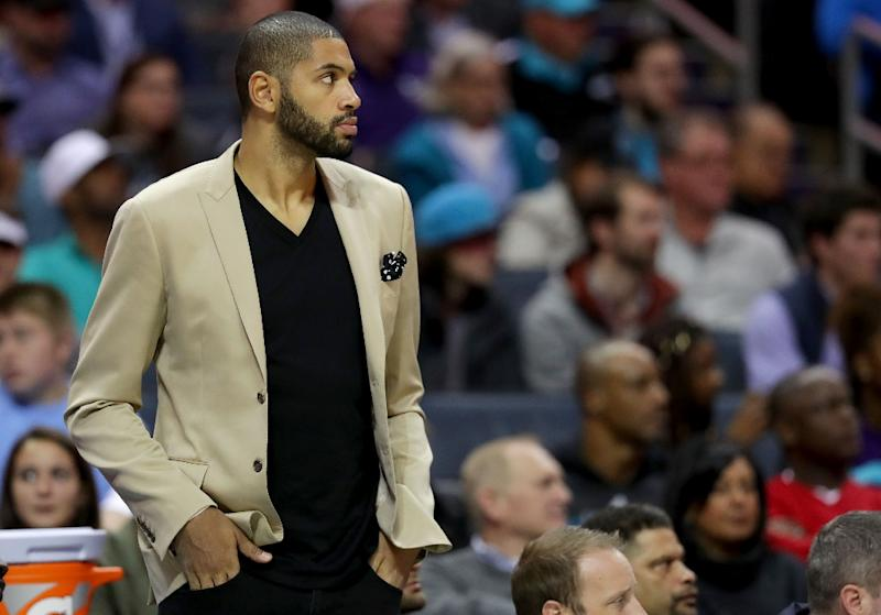 Nicolas Batum of the Charlotte Hornets watches on from the bench against the Orlando Magic during their game at Spectrum Center on October 29, 2017 in Charlotte, North Carolina