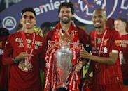 Liverpool's Brazilian trio (from left to right) Roberto Firmino, Alisson Becker and Fabinho could miss the Premier League match against Leeds (AFP/PHIL NOBLE)