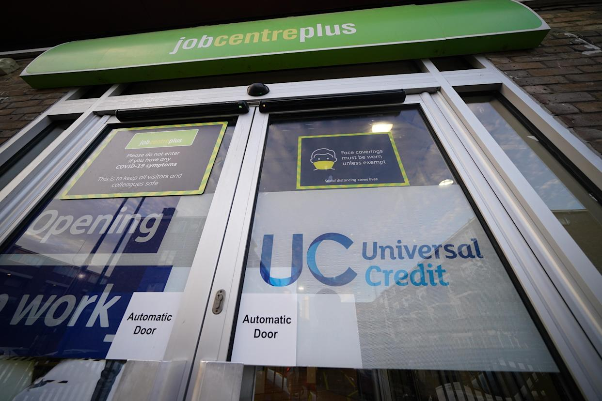 A Universal Credit sign on a door of a job centre plus in east London. Recipients of Universal Credit (UC) have described feeling