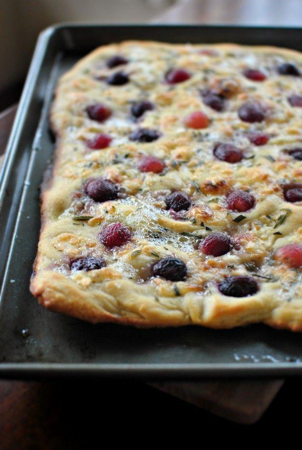 """<p>Well, if there's grapes in the pizza, you absolutely have to open a bottle of wine.</p><p>Get the recipe at <a href=""""http://www.simplyscratch.com/2013/12/roasted-red-grape-brie-and-rosemary-flatbread.html#comment-275573"""" rel=""""nofollow noopener"""" target=""""_blank"""" data-ylk=""""slk:Simply Scratch"""" class=""""link rapid-noclick-resp"""">Simply Scratch</a>.</p>"""